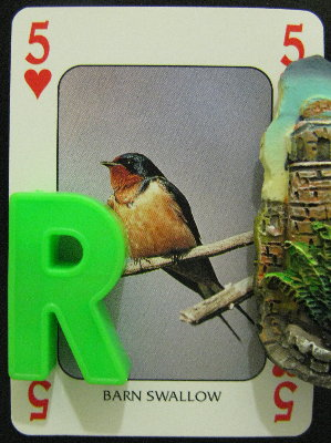 Five of Hearts featuring a Barn Swallow, with the letter R and a castle turret