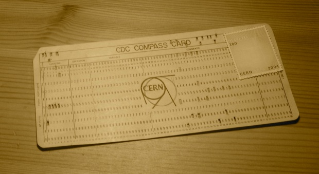 A punched card with a stamp on it and a message punched in ASCII.
