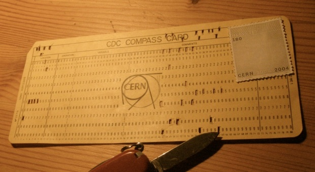 The same punch card again, but with the Swiss Army knife used to punch the holes.