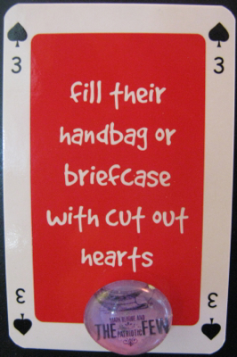 Three of spades saying 'fill their handbag or briefcase with cut out hearts'