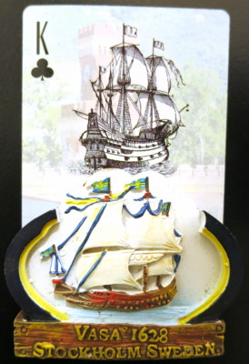 A king of clubs with a ship on it