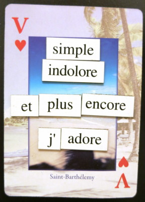 Magnetic poetry giving HeartValet's rhyming slogan in French: 'simple, indolore, et plus encore. J'adore' which roughly translates to 'simple, painless, and more; I love [it].'