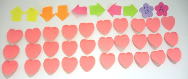 Konami code in arrow-shaped Post-Its, with 30 heart Post-Its below