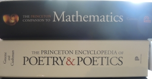 A picture of the Sun peeking over the spine of The Princeton Companion to Mathematics as it rests on top of The Princeton Encyclopedia of Poetry & Poetics